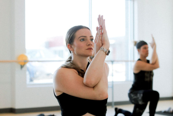 woman doing yoga as part of post-pandemic social routine